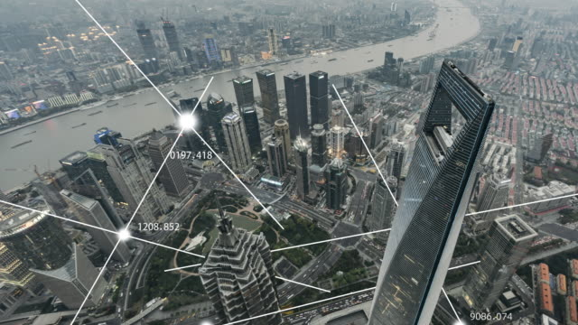 t/l zi aerial view of city network of shanghai, day to dusk transition - smart city stock videos & royalty-free footage