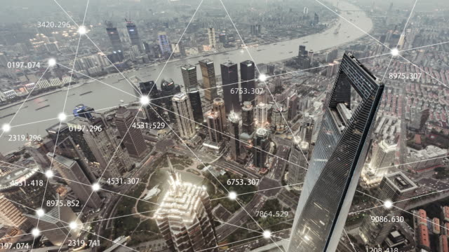 t/l zo aerial view of city network of shanghai, day to dusk transition - new business stock videos & royalty-free footage