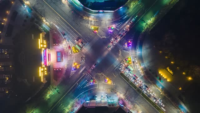 aerial view of city street crossing at night - crossing stock videos & royalty-free footage