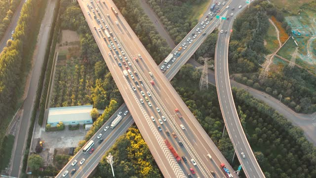 aerial view of  city traffic at sunset - motorway junction stock videos & royalty-free footage