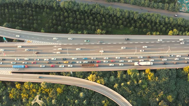 aerial view of  city traffic at sunset - aircraft point of view stock videos & royalty-free footage