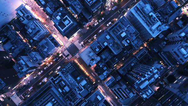 aerial view of cityscape at night - grandangolo tecnica fotografica video stock e b–roll