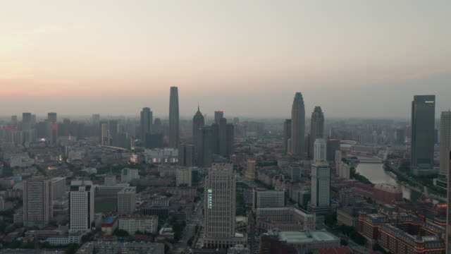 aerial view of cityscape at sunset - liyao xie stock videos & royalty-free footage