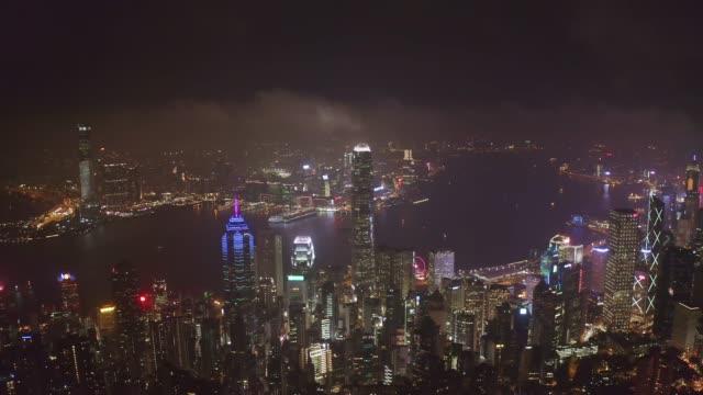 stockvideo's en b-roll-footage met luchtfoto van het stadscentrum verkeer in victoria harbour in hong kong china 's nachts - stadscentrum hongkong hongkong