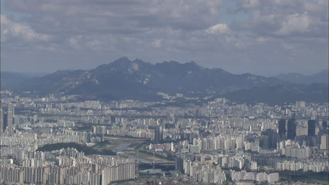 Aerial View of cityscape of Seoul with Bukhansan mountain