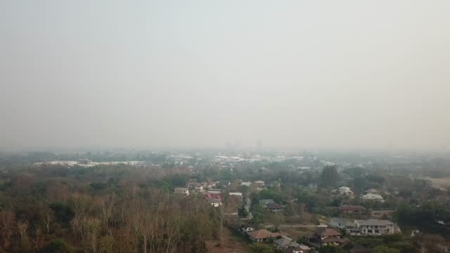 aerial view of cityscape smoggy pollution in chiang mai, thailand. - chiang mai city stock videos and b-roll footage