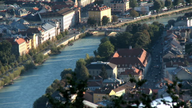aerial view of cityscape with river going through - innsbruck stock videos and b-roll footage