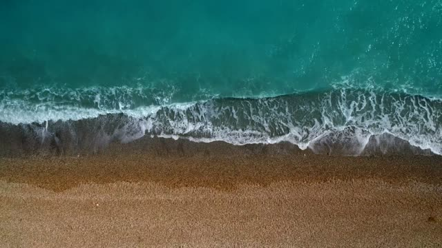aerial view of clear turquoise sea and waves - bay of water stock videos & royalty-free footage