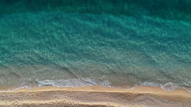 aerial view of clear turquoise sea and waves - beach stock videos & royalty-free footage