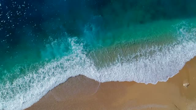 aerial view of clear turquoise sea and waves - overhead view stock videos & royalty-free footage
