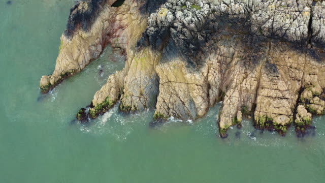 aerial view of cliffs on a section of scottish coastline as the tide comes in - johnfscott stock videos & royalty-free footage