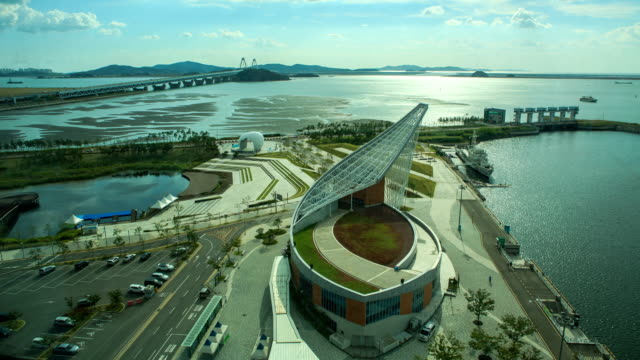 stockvideo's en b-roll-footage met aerial view of cloud, car, high tide, and low tide around yeongjongdaegyo, jeongseojin -> high angle view of gyeongin ara waterway terminal in incheon - incheon