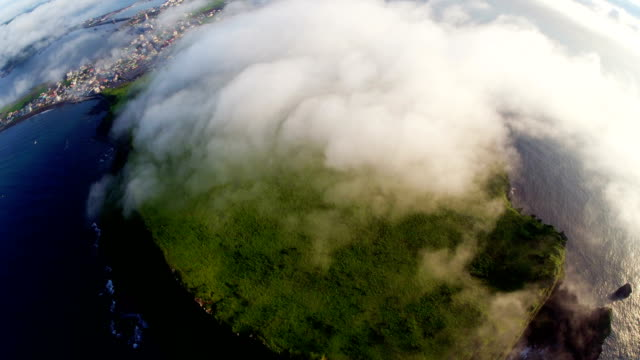 Aerial view of cloud-covered Seongsanilchulbong cliff (UNESCO World Heritage Site)