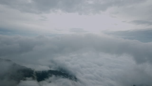 aerial view of clouds and sky on the mountain at sunrise - covering stock videos & royalty-free footage