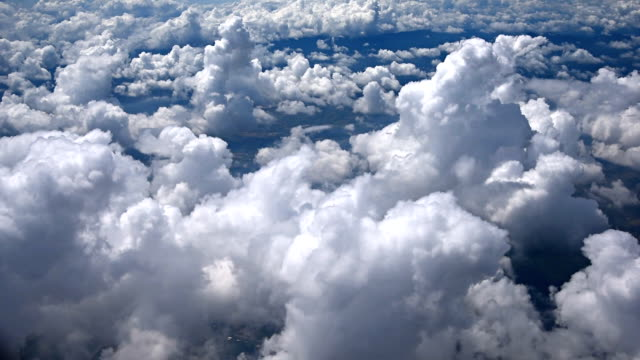 Aerial view of clouds, mountains from airplane, Vietnam