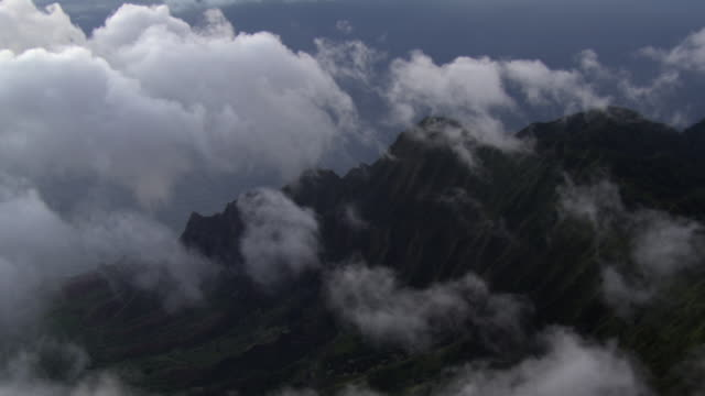 aerial view of clouds over kalalau valley in na pali coast state park, kauai island, hawaii, united states of america. - na pali coast state park stock videos & royalty-free footage