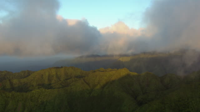 aerial view of clouds over steep ridges in na pali coast state park on kauai island, hawaii, united states of america. - na pali coast state park stock videos & royalty-free footage