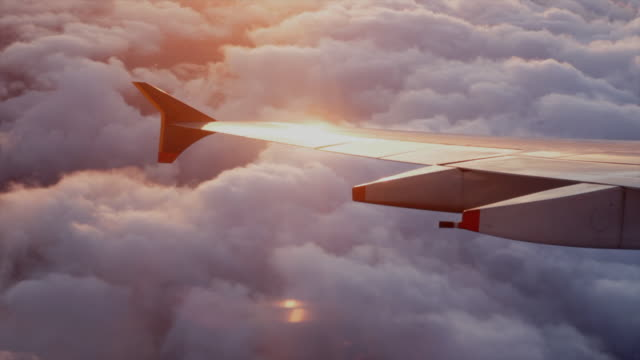 w/s aerial view of clouds with sun hilight on wing of singapore airlines a380  aircraft /united kingdom - air vehicle点の映像素材/bロール
