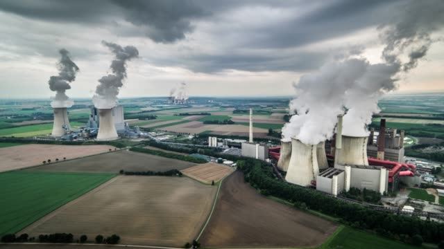 aerial view of coal burning power plants - coal fired power station stock videos & royalty-free footage