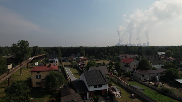 aerial view of coal-fired belchatow power station in belchatow, lodzkie, poland on thursday, july 8, 2021. the coal-fired power station is the... - smoke stack stock videos & royalty-free footage