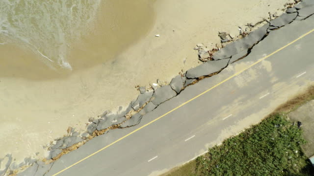aerial view of coastal line road damaged - eroded stock videos & royalty-free footage