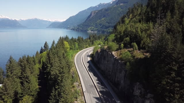 aerial view of coastal road and mountains, british columbia, canada - british columbia stock videos & royalty-free footage