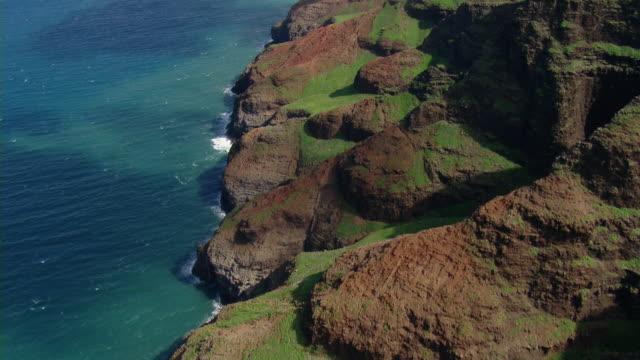 aerial view of coastal rock formations on the hawaiian island of kauai. - big island hawaii islands stock videos and b-roll footage