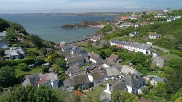 aerial view of coastal settlement, cornwall region - coastline stock videos & royalty-free footage