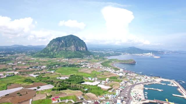 Aerial view of Coastal Village and Sanbangsan mountain in distance