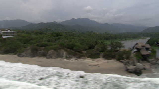 aerial view of coastline of tayrona national natural park [parque nacional natural tayrona], sierra nevada, colombia from helicopter - südamerika stock-videos und b-roll-filmmaterial