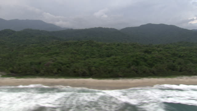 aerial view of coastline of tayrona national natural park [parque nacional natural tayrona], sierra nevada, colombia from helicopter - gebirge stock-videos und b-roll-filmmaterial