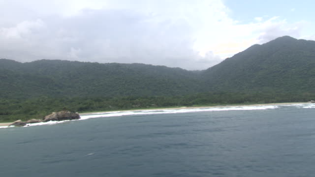 aerial view of coastline of tayrona national natural park [parque nacional natural tayrona], sierra nevada, colombia from helicopter - parque natural stock videos and b-roll footage