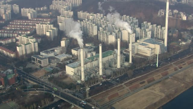 aerial view of cogeneration plant and cityscape in mok-dong, seoul, south korea - power station stock videos & royalty-free footage