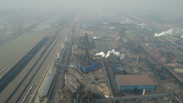 aerial view of coking plant and smog on march 17, 2017 in huanghua, china. . - coal mine stock videos & royalty-free footage