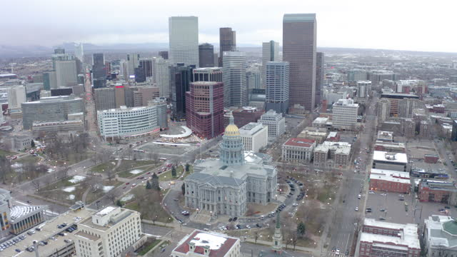 aerial view of colorado state capitol against sky, drone panning over cityscape during sunset - denver, colorado - world politics stock videos & royalty-free footage
