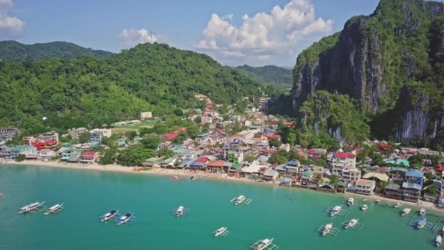 aerial view of colorful buildings in el nido town, palawan, philippines - filippine video stock e b–roll