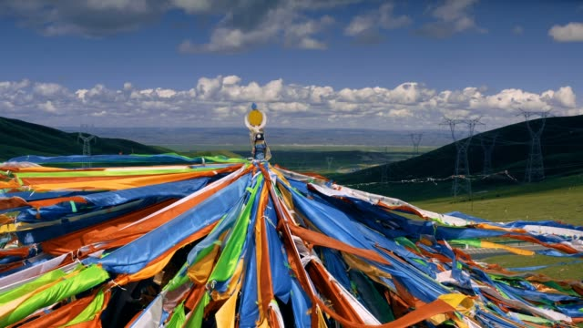 aerial view of colorful flags on the mountain in qinghai, china. - traditionally tibetan stock videos & royalty-free footage