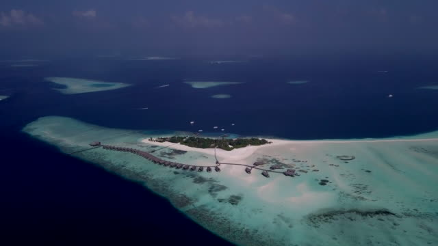 aerial view of colorful maldives sea and resort - panoramic stock videos & royalty-free footage