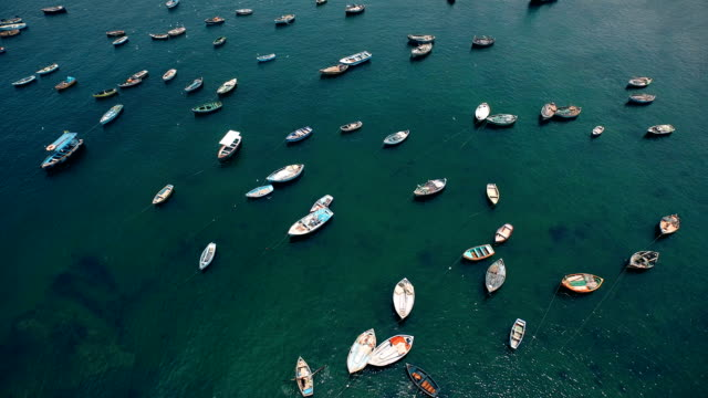 aerial view of colorful peruvian fishing boats in harbor - lima peru stock videos and b-roll footage