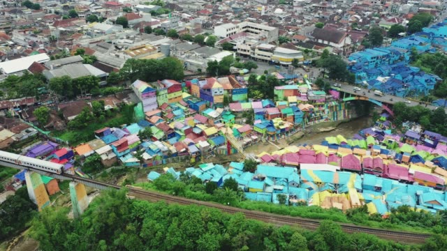 aerial view of colorful rainbow village in malang, java - slum stock videos & royalty-free footage
