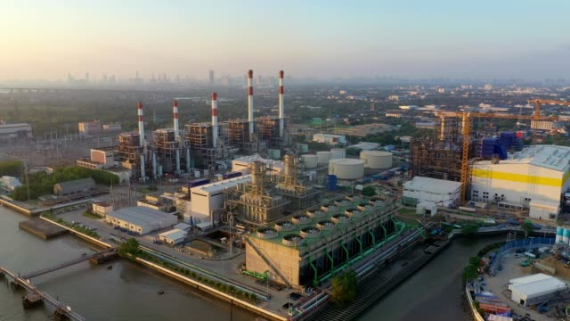 aerial view of combined cycle power plant and cooling tower at sunset - fast motion stock videos & royalty-free footage