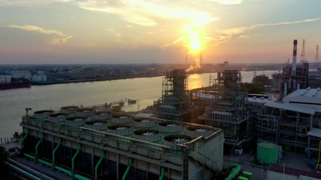 aerial view of combined cycle power plant and cooling tower at sunset - cooling tower stock videos & royalty-free footage