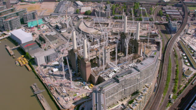 aerial view of construction at battersea power station, london, uk. 4k - battersea stock videos & royalty-free footage