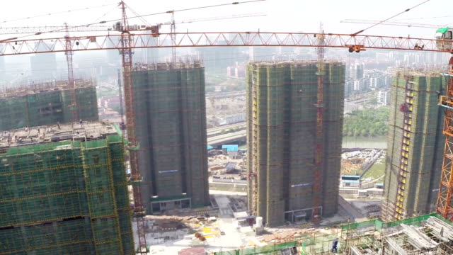 Aerial view of construction site and cranes,real time.