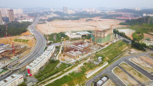 aerial view of construction site beside highway - continuity stock videos & royalty-free footage