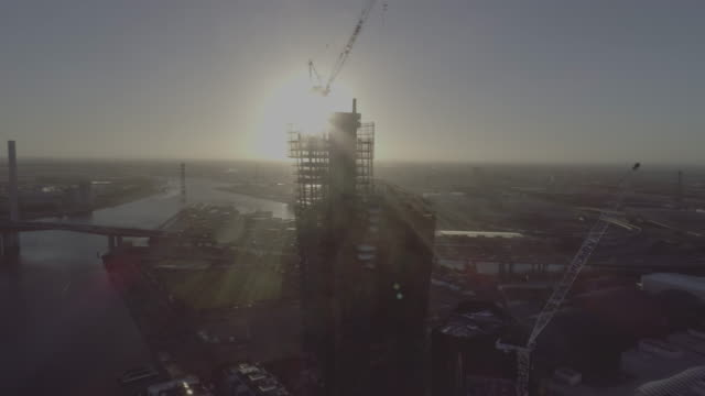 aerial view of construction site docklands, melbourne victoria australia - crane stock videos & royalty-free footage