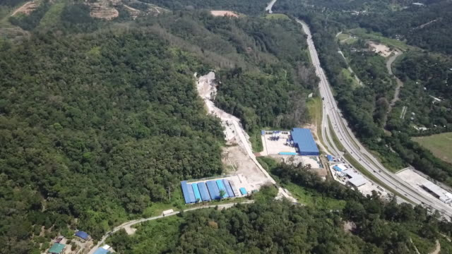 aerial view of construction site of east coast rail link built by china communications construction co bentong pahang malaysia on sunday may 2 2019 - マレーシア点の映像素材/bロール