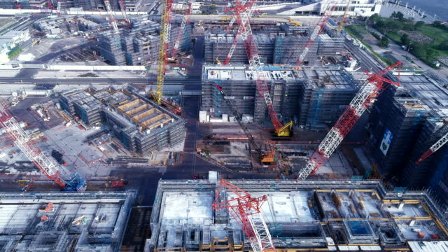 stockvideo's en b-roll-footage met aerial view of construction site - bouwmachines