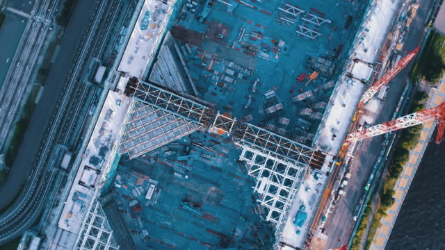 aerial view of construction site - construction frame stock videos and b-roll footage