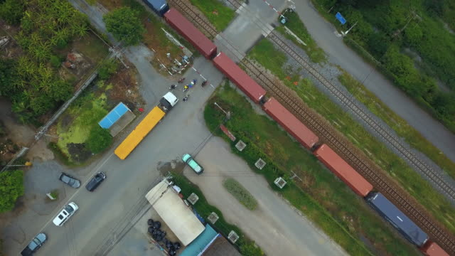 aerial view of container freight train transporting goods across the country - passenger train stock videos & royalty-free footage